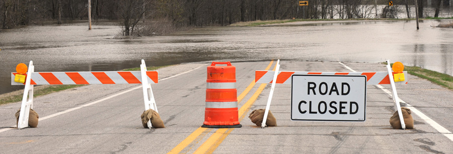 Image of road closed sign at flooded road