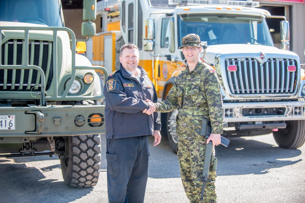 Fire Chief and CAF Officer shake hands