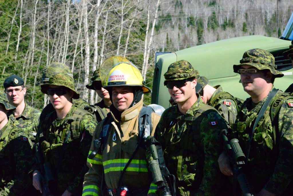 Soldiers and firefighters prepare