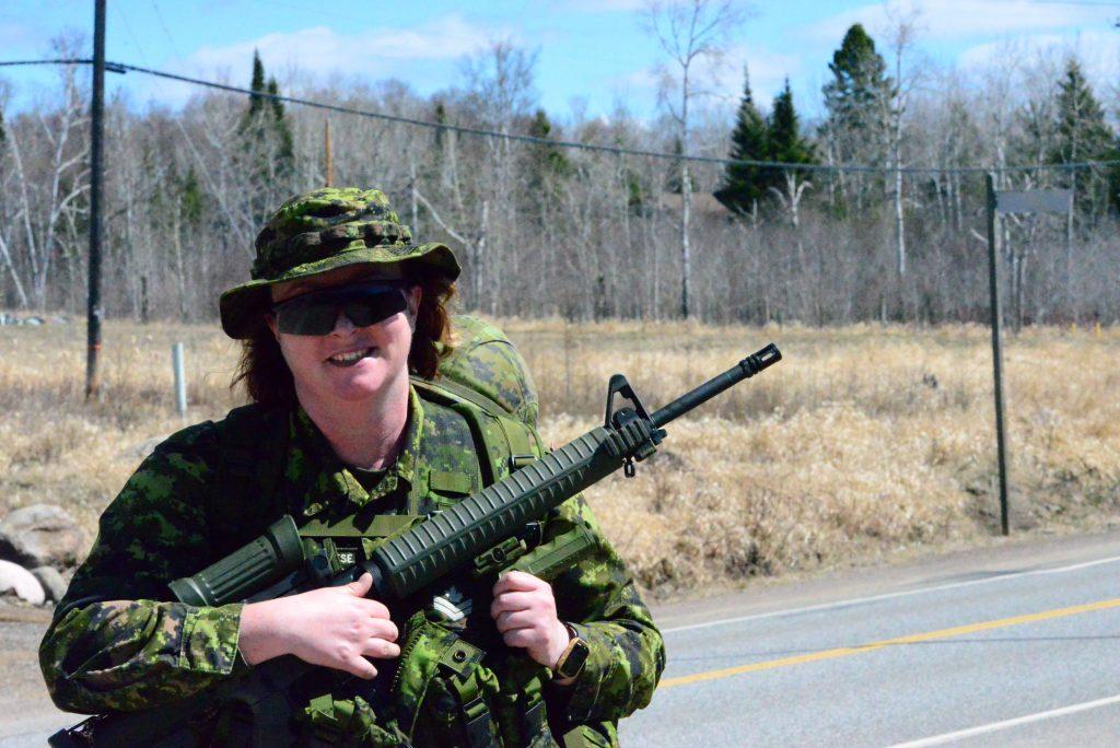 female soldier posing