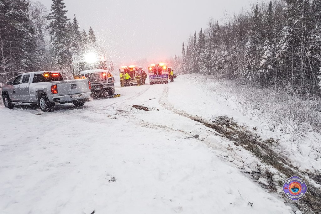 Emergency vehicles on road with ruts in the ditch